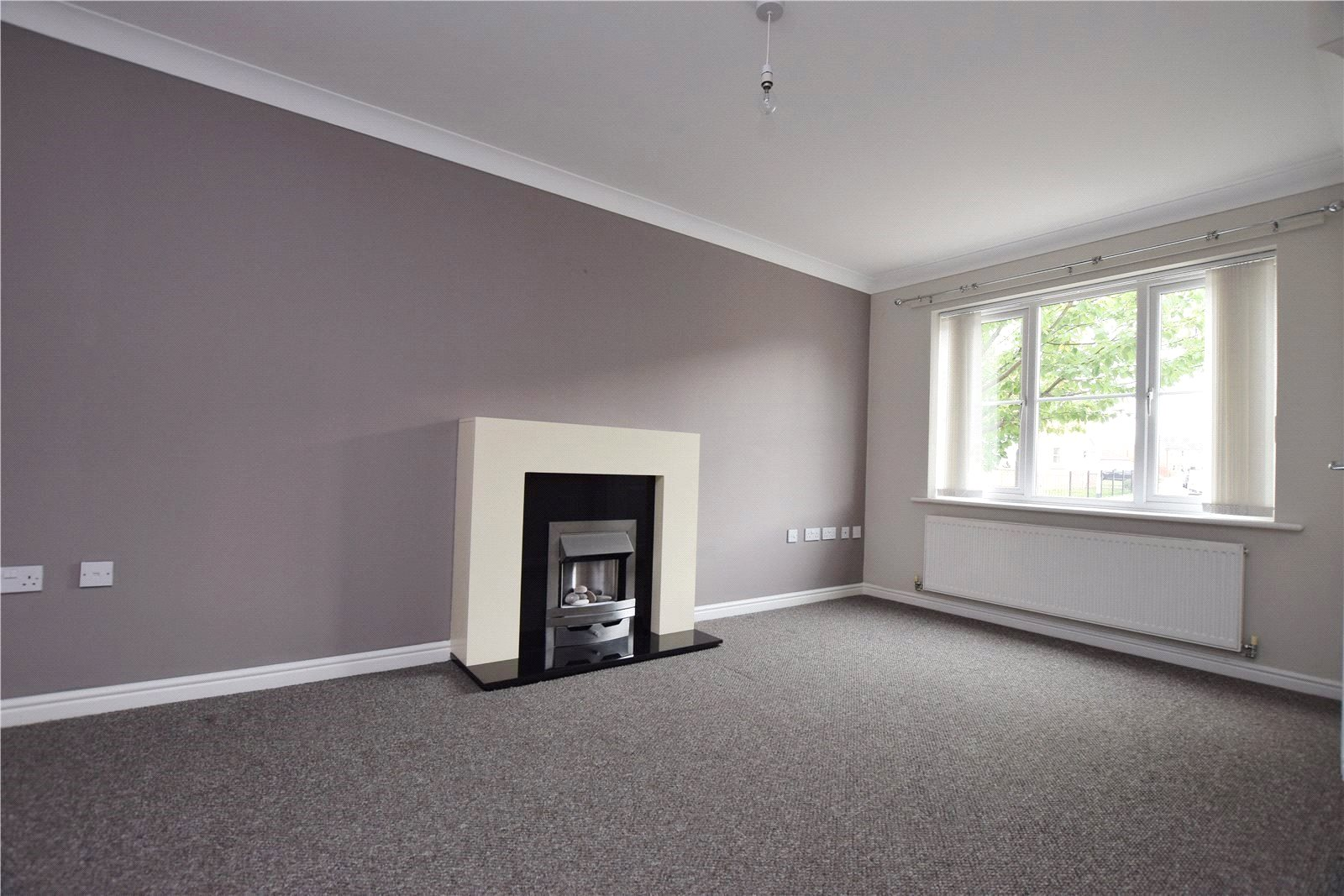 Property to let in Leeds, reception room area fire place and gray carpet, modern