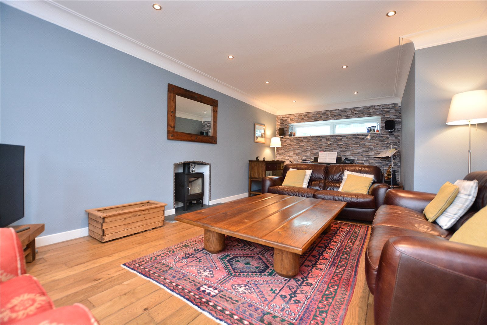 Property for sale in Oakwood, interior reception room, spacious with 2 leather sofas