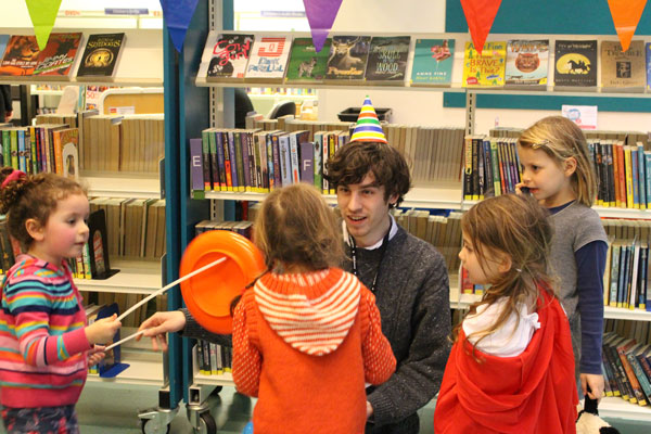 Children try their hand at circus skills with library staff
