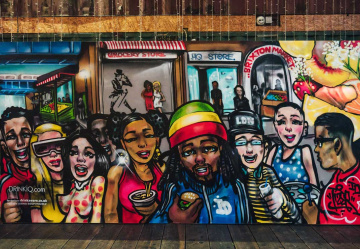 Pop art at its best! Brixton graffiti king Tizer creates street mural with a certain fizz